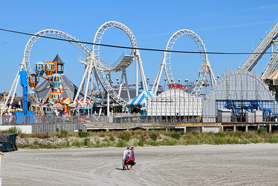 "With the Amusement Rides in the distance, beach lovers hate to give up a gorgeous day... Wildwood Beach... ""Bike Rally"" weekend Sept 7, 2013"