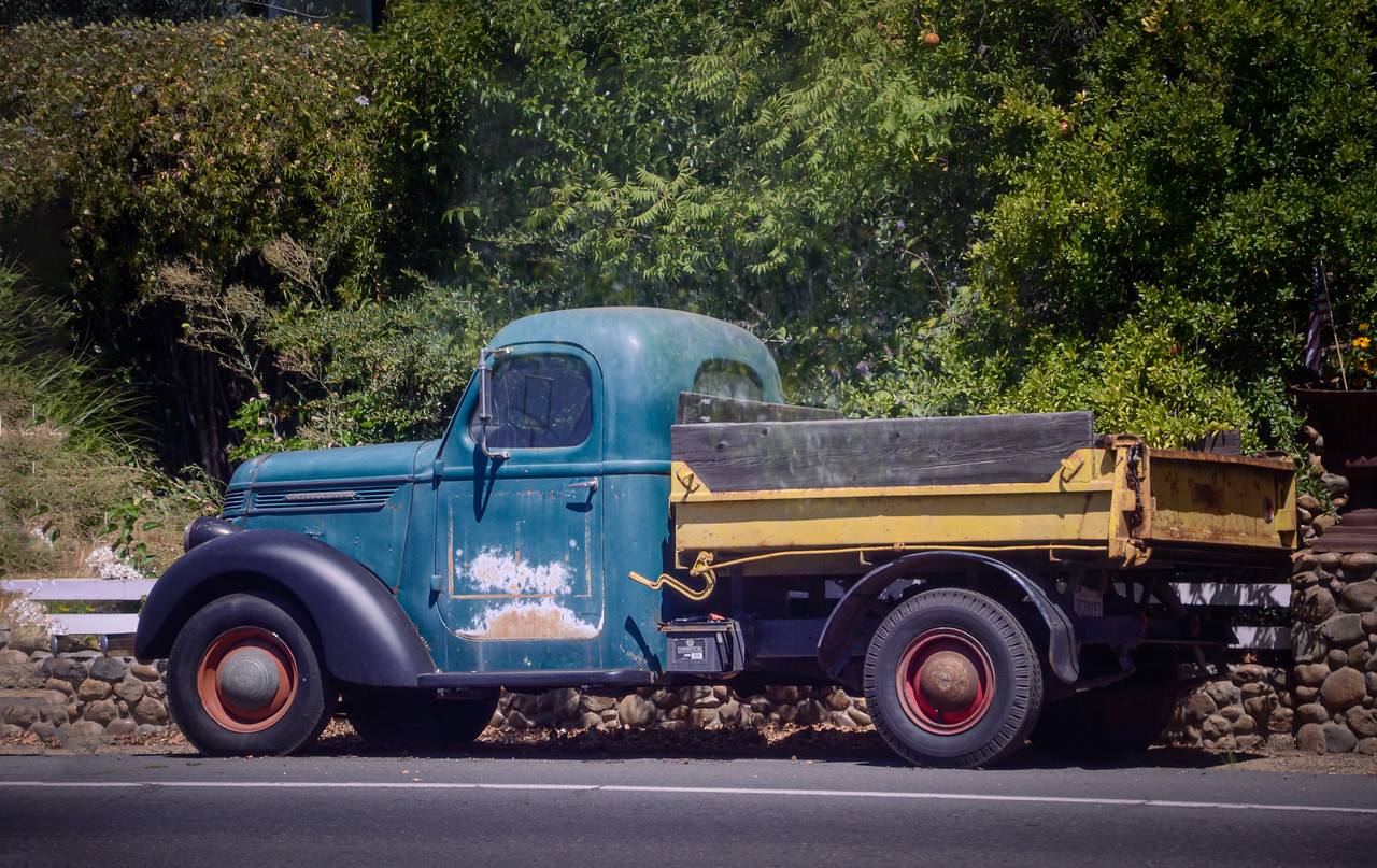 Old truck parked along the tracks.