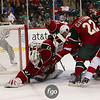 Minnesota Wild goaltender Jimmy Howard (35) stretches to keep the puck under control in the first period of the hockey game between the Red Wings and the Wild at the Xcel Energy Center in St. Paul Minnesota. The Wild led the game 1-0 in the first period and The Red Wings went on to win 3-2 in overtime.