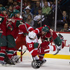 Minnesota Wild defenseman Marco Scandella (6) puts a hit on Detroit Red Wings right wing Patrick Eaves (17) in the second period of the hockey game between the Detroit Red Wings and the Minnesota Wild at the Xcel Energy Center in St. Paul, Minnesota. The Wild led 2-1 after two periods and the Red Wings won the game 3-2 in overtime.