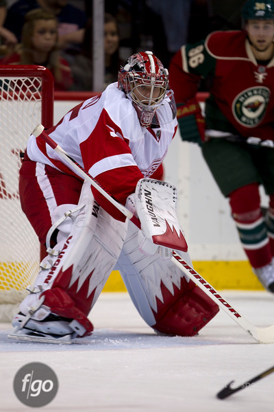 Detroit Red Wings goaltender Jimmy Howard (35) saw just 14 shots on goal and saved 12 of them in the hockey game between the Detroit Red Wings and the Minnesota Wild at the Xcel Energy Center in St. Paul, Minnesota. The Red Wings won the game 3-2 in overtime.