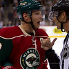 Minnesota Wild captain center Mikko Koivu has words with linesman Ryan Galloway (82) during a timeout in the hockey game between the Detroit Red Wings and the Minnesota Wild at the Xcel Energy Center in St. Paul, Minnesota. The Red Wings won the game 3-2 in overtime.