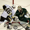 Minnesota Wild goalie Niklas Backstrom (32) makes a save under pressure by Pittsburg Penguins center Joe Vitale (46) in the first period of a hockey game between the Penguins and Wild at the Xcel Energy Center in St. Paul Minnesota. The Penguins won the game 4-2.