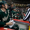 Minnesota Wild captain center Mikko Koivu (9) looks on as linesman Dan Schachte (47) speaks with a Wild coach in the third period of a hockey game between the Pittsburgh Penguins and the Minnesota Wild at the Xcel Energy Center in St. Paul Minnesota. The Penguins won the game 4-2.