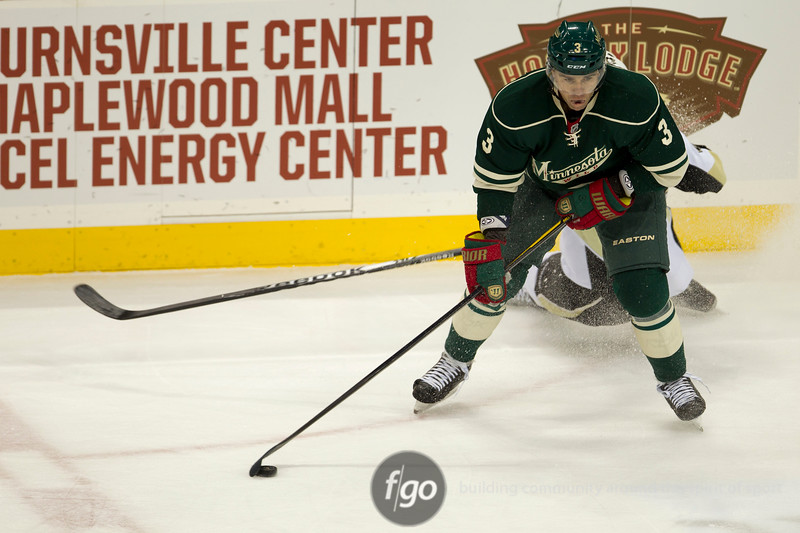 Minnesota Wild defenseman Marek Zidlicky (3) pulls one off the boards in the first period of a hockey game between the Penguins and Wild at the Xcel Energy Center in St. Paul Minnesota. The Penguins won the game 4-2.