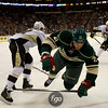 Minnesota Wild center Kyle Brodziak (21) trips while Pittsburgh Penguins center Jordan Stahl (11) controls the puck in the second period of a hockey game between the Penguins and Wild at the Xcel Energy Center in St. Paul Minnesota. The Penguins won the game 4-2.