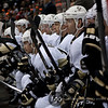 Pittsburgh Penguins left wing Chris Kunitz (14) leans forward with his team as they watch the on-ice action in the third period of a hockey game between the Penguins and Wild at the Xcel Energy Center in St. Paul Minnesota. The Penguins won the game 4-2.