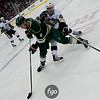 Minnesota Wild defenseman Marco Scandella (6) controls the puck under pressure from Pittsburgh Penguins center Joe Vitale (46) in the third period of a hockey game between the Pittsburgh Penguins and the Minnesota Wild at the Xcel Energy Center in St. Paul Minnesota. The Penguins won the game 4-2.
