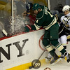 Minnesota Wild defenseman Clayton Stoner (4) and Pittsburg Penguins defenseman Ben Lovejoy (6) crash into the boards in the first period of a hockey game between the Penguins and Wild at the Xcel Energy Center in St. Paul Minnesota. The Penguins won the game 4-2.