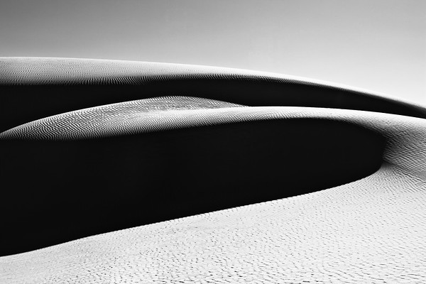 Black and white abstract of sand dunes taken at White Sands National Park, New Mexico