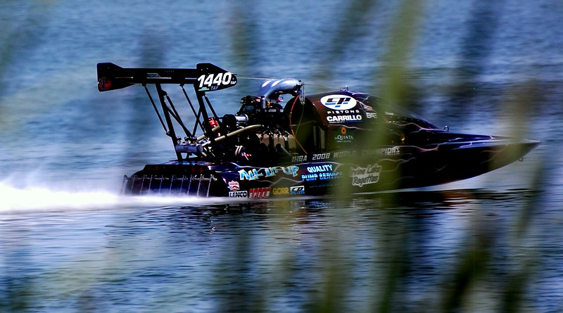 A flier for sure!  A Pro Mod boat racing at Fort Worth, TX, but he didn't beat my brother Marty Logan.  Linda