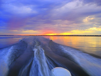 Racing home to beat the sundown on the Parana River in Argentina  This photograph is protected by the U.S. Copyright Laws and shall not to be downloaded or reproduced by any means without the formal written permission of L Good - noelxgood@sbcglobal.net.