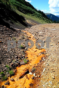 2013  This is an interesting little stream that was flowing out from an abandoned mine near Ouray, Colorado.  The path worn by the water was narrow, and golden yellow in color.  I presume that the color was caused by minerals in the soil or the water itself.  I'm not sure, nevertheless I thought it was intersting.  For a couple more shots from this area, click on the following links:  Thanks for visiting.  Linda