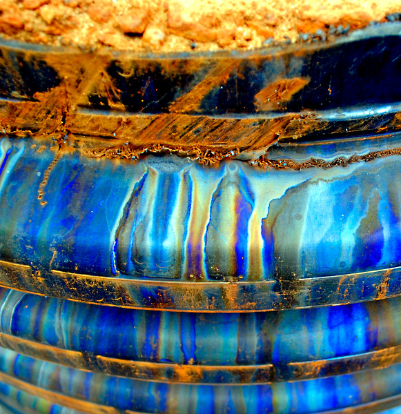 Rusty barrel, with rainbow-like colors.