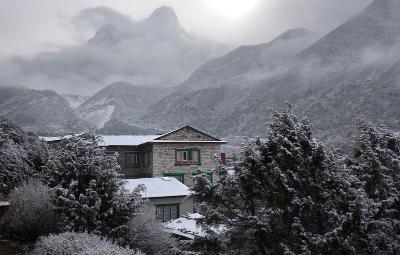 A Little Bit of Color, Khumbu Valley - Nepal<br /> <br /> A passing morning snowstorm creates a monochromatic vista of the distant peak, Ama Dablam. The teahouse in the foreground radiates its primary colors of the traditionally painted features of almost all of the homes in the Sherpa valley.