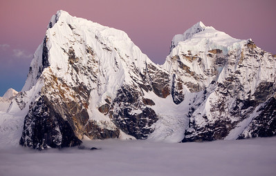 Cholatse, Gokyo Valley - Nepal  Sunset on the staggeringly beautiful peak of Cholatse (21,129 ft), in the Gokyo Valley of Nepal. The summit to the right is Tawoche (21,463 ft). This image was taken from the summit of Gokyo Ri, where we were just a hundred meters above the valley fog.