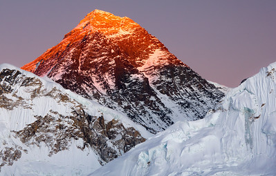 Everest at Sunset, Khumbu - Nepal  Mt. Everest (29,035 ft), glows orange with the last rays of evening sunshine. Taken from Kala Patar (18,192ft), a small Himalayan foothill, the sunset provided a spectacular visual opportunity - and absolutely no additional heat. We descended in complete darkness, by headlamp.