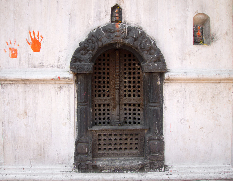 The Orange Hand, Kathmandu - Nepal<br /> <br /> Within the walls of Pashupatinath, the expansive Hindu temple grounds in Kathmandu, you will find many small doors and nooks; fabulously carved and adorned with dyes and marigolds.