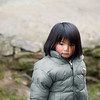 Namche Girl - Nepal<br /> <br /> Children of the Himalayan village of Namche bundle up with down jackets against the evening cold. Increasingly, the Sherpa children have taken on the function of western fashion over the local warmth of wool and fur.