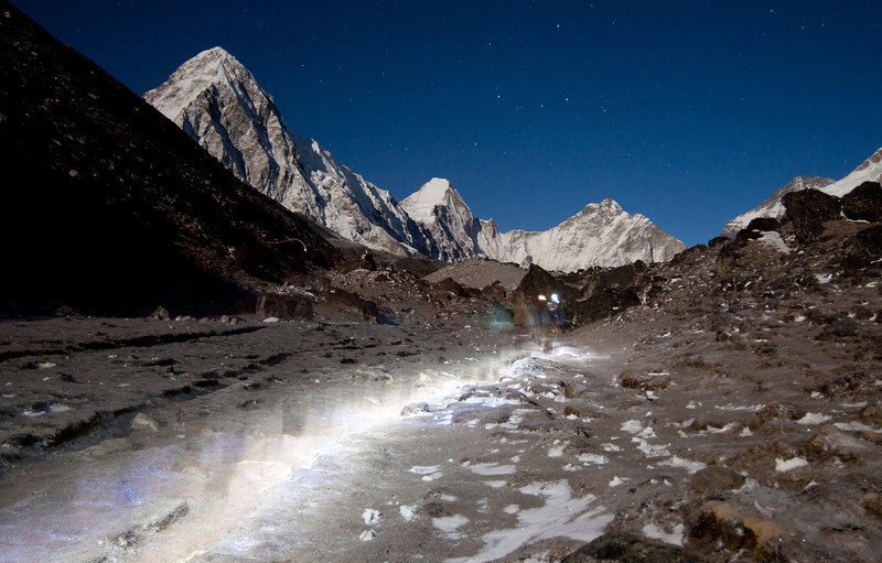 Hiking at Night, Pumori - Nepal<br /> <br /> 4am start from Lobuche to Gorak Shep, en route to Kala Patar. Headlamps illuminate a ghostly path along the lateral moraine of the Khumbu Glacier, with Pumori standing tall against the stars to the left.