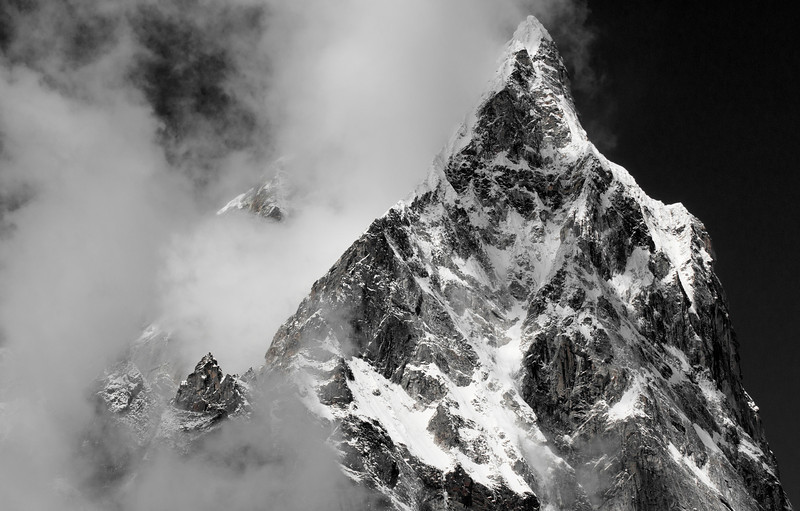 East Ridge of Tawoche, Khumbu Valley - Nepal<br /> <br /> Low clouds hurried by all day, giving only brief glimpses of the surrounding mountains. Then, from above the village of Pheriche, just below the terminal moraine of the Khumbu Glacier, this startling  scene stole the show.