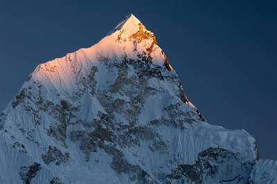 Nupste Sunset - Nepal  The wicked steep west ridge of Nuptse (25,790 feet) in the Khumbu Himalaya. It shares its other ridge with Lhotse and Mt. Everest.