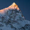 Nupste Sunset - Nepal<br /> <br /> The wicked steep west ridge of Nuptse (25,790 feet) in the Khumbu Himalaya. It shares its other ridge with Lhotse and Mt. Everest.