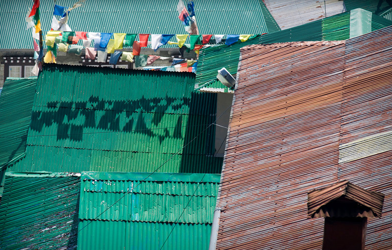 Namche - Nepal<br /> <br /> Corrugated tin roofs, some painted, some rusted, overlap in a geometrical palette of metallic color and texture.  Namche, the trading and trekking hub of the Khumbu valley, has become a quickly growing community in the past 25 years, and includes electricity from both solar and hydroelectric sources.