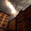 Crack in the Sky, Kathmandu - Nepal<br /> <br /> A sudden storm over the tourist district of Kathmandu settled the dust and exhaust, played hide and seek with the power, and sent streamers of lighting into the nearby hillside. The men working on this makeshift bamboo ladder continued to paint the face of the Vaishali Hotel, only crouching on a window ledge during the loudest thunder.