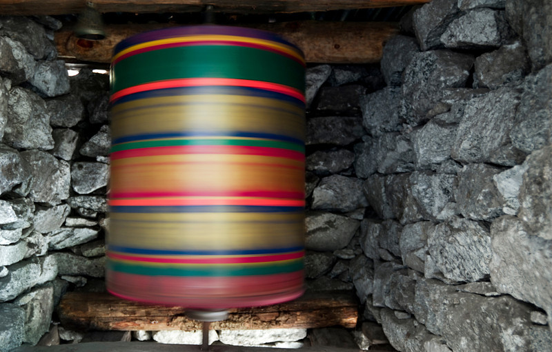 Wheel of Prayer, Khumbu Valley - Nepal<br /> <br /> A brightly colored prayer wheel squeaks and whirls, powered only by a small cold creek, and housed inside a four-foot tall stone structure. These simple machines are not used for power, but to accumulate wisdom and  good karma for the builder.