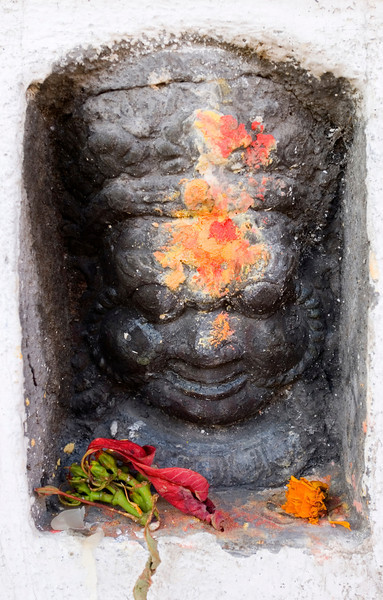 Tiny Temple, Kathmandu - Nepal<br /> <br /> A tiny stone cubby-hole, containing a carved likeness of Buddha, is decorated by local Hindus during the festival of lights in November.