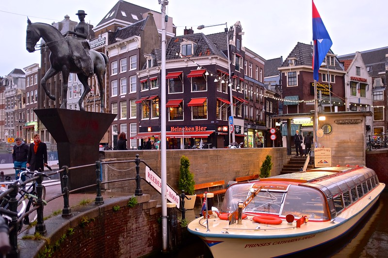 Canal Boat and City Life - Amsterdam, Netherlands