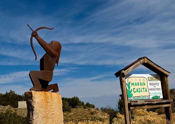 "The sign and Native-American sculpture are outside the Madrid Casita, in Madrid, New Mexico. See their website at: <a href=""http://www.madridcasita.com/"">http://www.madridcasita.com/</a>"