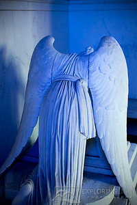 """WEEPING ANGEL V""New Orleans, LouisianaThe Weeping Angel mourns, as the setting sun casts a bluish hue through the stained glass.© Chris Moore - Exploring Light PhotographyPURCHASE A PRINT"