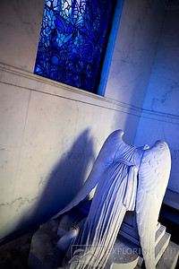 """WEEPING ANGEL VII""New Orleans, LouisianaThe Weeping Angel mourns, as the setting sun casts a bluish hue through the stained glass.© Chris Moore - Exploring Light PhotographyPURCHASE A PRINT"