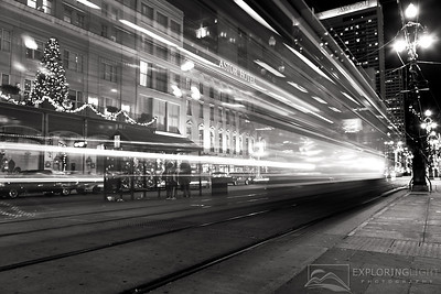 """TIME TRAVELER""New Orleans, LouisianaA streetcar races down Canal Street in the heart of the French Quarter on Christmas day.© Chris Moore - Exploring Light PhotographyPURCHASE A PRINT"