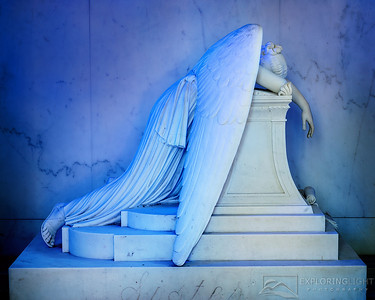 """WEEPING ANGEL III""New Orleans, LouisianaThe Weeping Angel mourns, as the setting sun casts a bluish hue through the stained glass.© Chris Moore - Exploring Light PhotographyPURCHASE A PRINT"