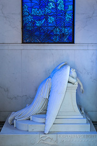 """WEEPING ANGEL II""New Orleans, LouisianaThe Weeping Angel mourns, as the setting sun casts a bluish hue through the stained glass.© Chris Moore - Exploring Light PhotographyPURCHASE A PRINT"