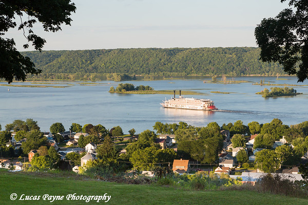 The American Queen River Boat travelling past Guttenberg, Iowa on the Mississippi River<br /> <br /> August 04, 2017
