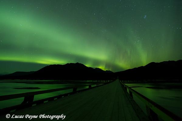 Aurora Borealis (Northern Lights) dancing above the Susitna River bridge along the Denali Highway.<br /> <br /> September 25, 2014