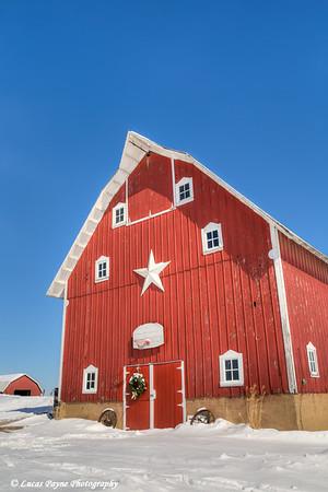 Red barn with freshly fallen snow on a farm near Edgewood in Northeast Iowa.<br /> <br /> February 26, 2015