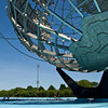 Skateboarders play under the unisphere in Flushing Meadow Park, Queens, NY