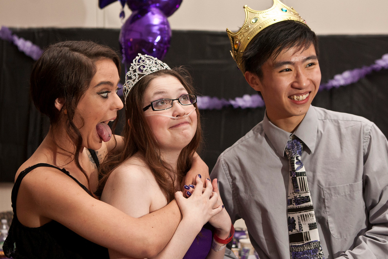 Meghan Demers, left, a PA resident traveled four hours to see her cousin, Brianna Dragunoff, center. The prom king, Tony Chen stands to the right at Gaylord Specialty Healthcare which made a wish come true for Brianna Dragunoff – a Wallingford teen battling Cystic Fibrosis. Brianna will be missing her prom at Sheehan High School, but thanks to the nurses at Gaylord Hospital – Brianna will experience going to prom! The nurses have pulled together to help create a special night for Brianna.