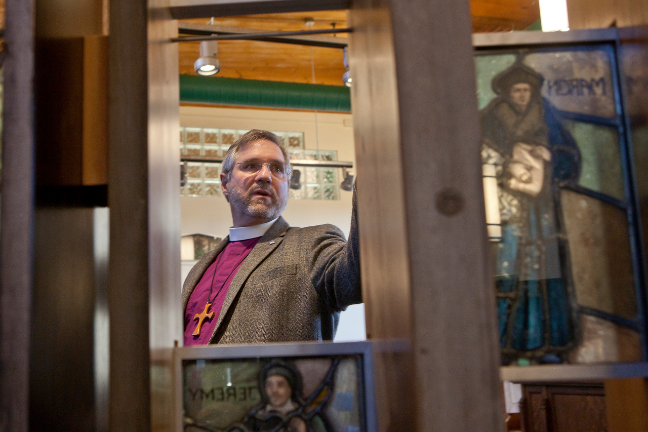 Episcopal Bishop Ian Douglas speaks with the Hartford Courant near a stained glass image of Martin Luther, the founder of the Protestant Reformation. A large section of the third floor of 290 Pratt Street in Meriden houses the new home office of the Episcopal Church in Connecticut, formerly located in a mansion in Hartford. November 20, 2014.