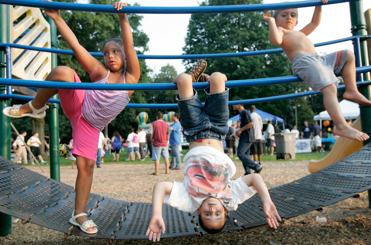 Adrianna Nevarez, 6, left, Gerry Cajigas, 6, center, and Alex Garcia, 3, right play on the playground during Meriden's National Night Out Festival at City Park August 4, 2009.
