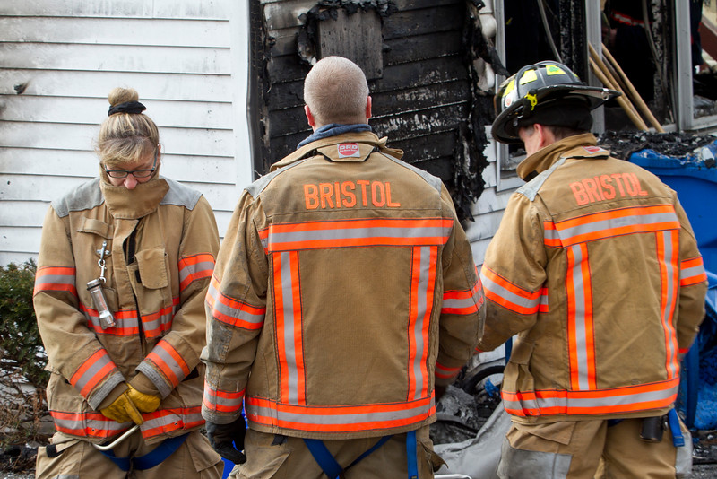 State Investigators inspect the Bristol home and business where a fire early Friday morning claimed the lives of two and badly damaged the property at 29 High Street in Bristol, CT. January 7, 2015.