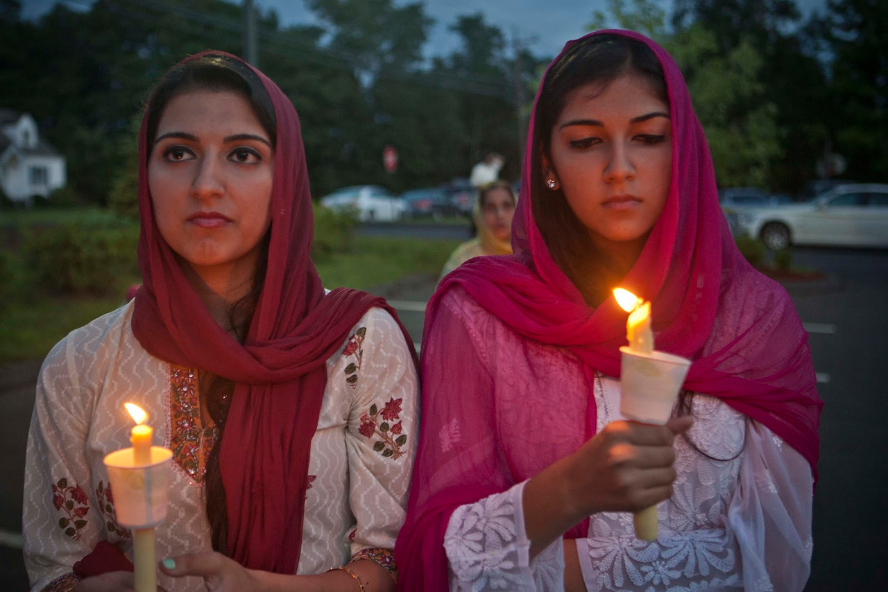 Glastonbury residents, left, Raveena Khanna, 19 and her sister,  Rayva Khanna, 16 , right, were two of more than 200 people who attended a memorial at the Gurdwara Guru Nanak Darbar, a Sikh Temple in Southington, Connecticut on August 10, 2012. A vigil was held to honor those who died and support the survivors of the fatal shooting in Oak Creek, WI.