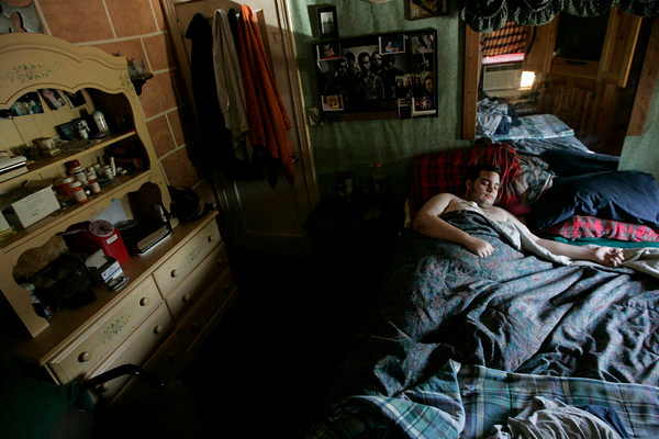 Jake DeMarco, 20, lies in his bed, resting. He has a brain condition known as a Chiari malformation. His brain presses against the back of his skull and into his his spinal cord. Light sensitive, unable to walk, sometimes partially blind and deaf he remains in his room which has increasing become his world over the last 20 months when his condition revealed itself. June 12, 2008.