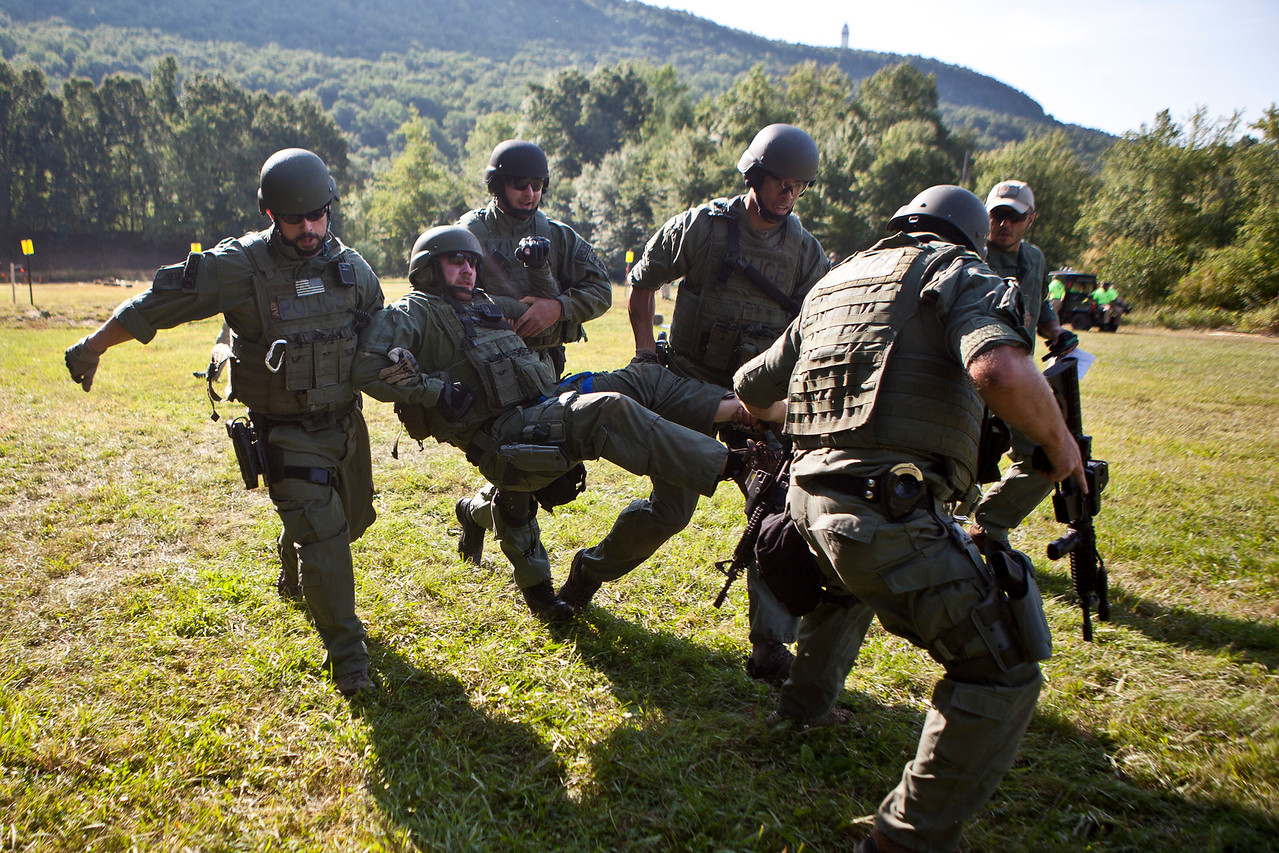 Hartford Police Officer, Matt Stienmetz is being carried by other members of the police force at Metacon Gun Club in Simsbury, which hosted the 10th Annual CT SWAT Challenge. Police Departments and Military Units from several states participated in numerous challenges including the officer rescue and hostage challenges.