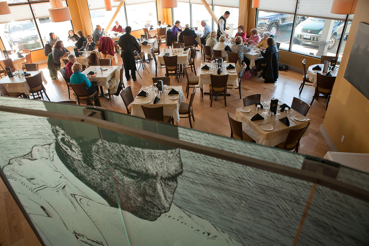 An etched glass divider separates the bar from the main dining room at Leon's Restaurant in North Haven, Connecticut on February 21, 2013.